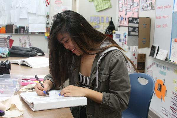 Abigayle Andoy, sophomore, sketches out one of her ideas for her skirt design.<br/>Photo Credit: Allison Ho
