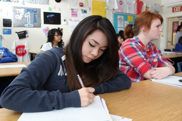 Beatrice Cacao takes notes on the lesson <br />about social contracts.<br>Photo Credit: Shantil Gamiao