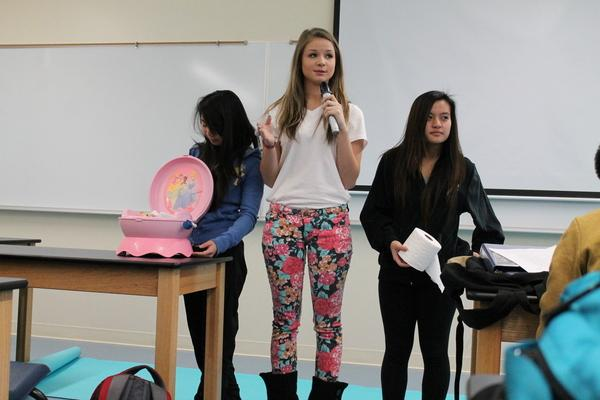 Pulling questions out of a potty-training toilet, sophomore medical students Allison Lan, Tara Eskic and <br />Kathleen Jaictin ask questions from their game involving urinary tract diseases.<br>Photo Credit: Hailey Basner