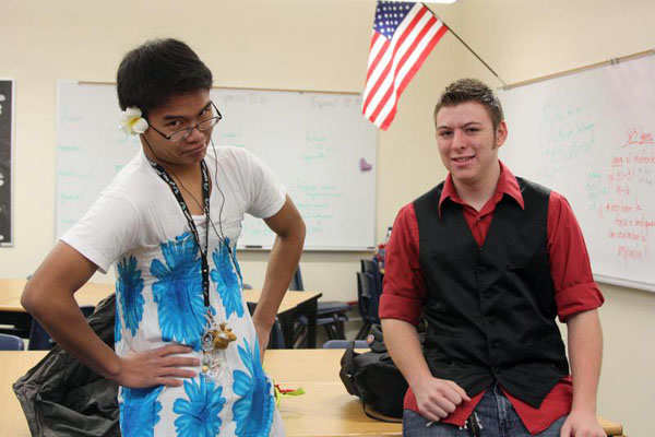 "Sophomore Joseph Salvador and senior Alejandro Sanchez participate in ""Dress vs Vest Day.""<br>Photo Credit: Allison Ho"