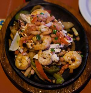 Fajitas Tres is a tasty dish that that includes steak, chicken, and/or shrimp.<br>Photo Credit: Estefania Cervantes
