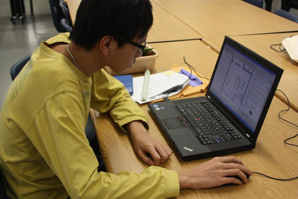 Senior William Zhang works on his Interior Design capstone that is due in May.<br>Photo Credit: Bree Eure