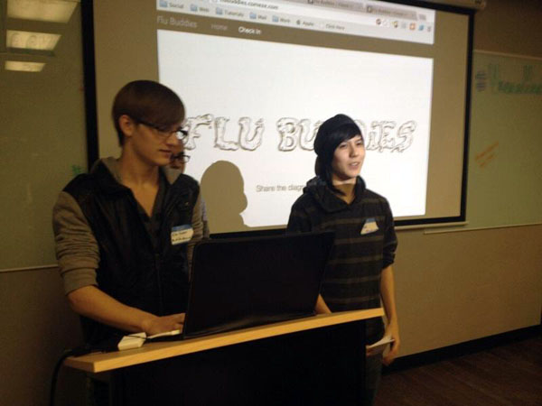 "Web Design seniors Michael Huebner and Dana Hackenberger present their app, ""Flu Buddies"" at the first Las Vegas Hackathon.<br>Photo Credit: Jonathan Cervantes"