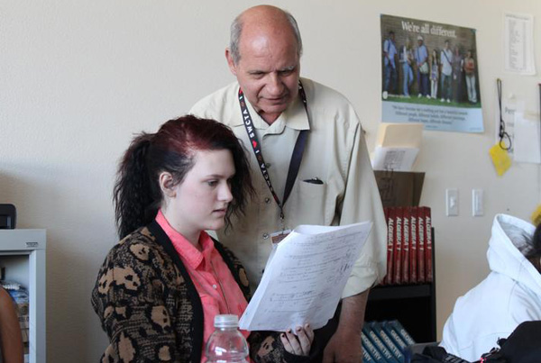Geometry teacher Mr. John Perri helps Hannah Hodson ('15) with a difficult proficiency practice question.Photo Credit: Shantil Gamiao