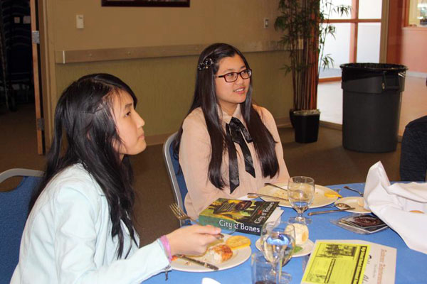 Freshmen Tiffany Chen and Tamara Navarro enjoy the luncheon as they eat a lunch prepared by the culinary program.Photo Credit: Raymond Tang
