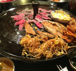 """Beef brisket is grilled with korean pancake, kimchi, and bean sprouts for """"Set B"""" at Honey Pig BBQ.<br>Photo Credit: Tamara Navarro"""