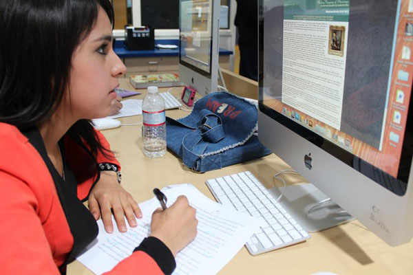 Estefania Cervantes researches information about the famous painter, Bartolome Esteban Murillo, for her Spanish III project.<br>Photo Credit: Shantil Gamiao