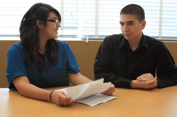 Senior Henry Martinez chats with junior Vivian Rivera about her upcoming trip to Spain.<br>Photo Credit: Bree Eure