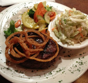 The famous pub steak served with vegetables, a side salad, and coleslaw for $10.99.<br>Photo Credit: Hailey Basner