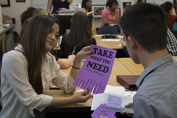 "Student Council Committee Chair Senior Andrea Salazar explains how to use the the ""Take What You Need Sheet"" for the Week of Respect.  Photo Credit: Michelle Manuel"