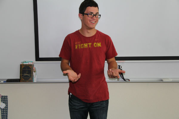 Freshman John Faccinto persuades the class of country music over rap.  Photo Credit: Bree Eure