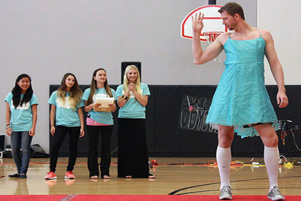 """Mr. Jeffrey Ball models a mini-dress that violates the CCSD Dress Code Policy as part of the """"No-No Fashion"""" show at the 2nd Annual Freshmen Assembly.Photo Credit: June Gabriel Santos"""