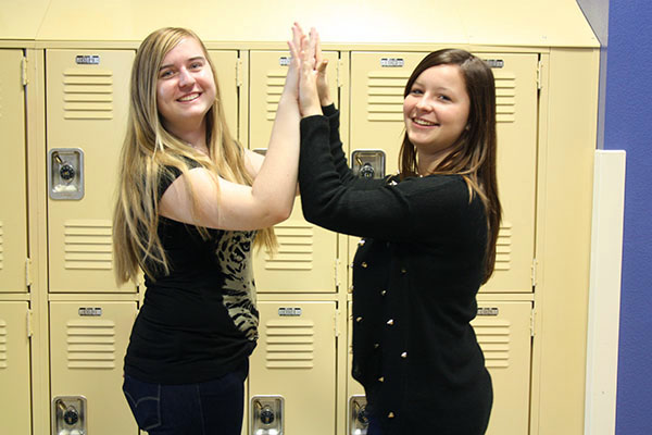 "Seniors Selma Mesic and Cassidy Medall participate in the first annual ""High Five"" Day.Photo Credit: Bree Eure"