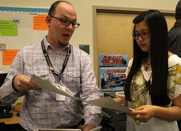 The Howl adviser Mr. Matthew LaPorte and Editor-in-Chief Tamara Navarro look over the awards won at the ceremony. Photo Credit: Brittnie Truax
