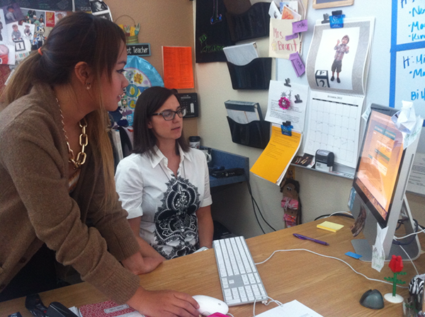 Mrs. Jennifer Brant helps sophomore Pattarasuda Atsawakaew with the Collaborize Classroom discussion. Students had to join the discussion last week and submit three truths and a lie. Their assignment was to comment on each other's posts to try and identify the lie.Photo credit: Mayra Valdez