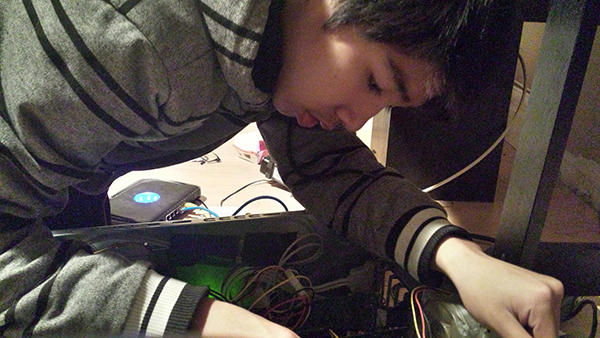 "Sophomore Ezra Ocampo installs a new random access memory (RAM) device into his computer tower. He had already finished assembling his computer when an issue occurred. ""I had to put in a new RAM because the old one fell out,"" Ocampo said.Photo Credit: Albert Ocampo"