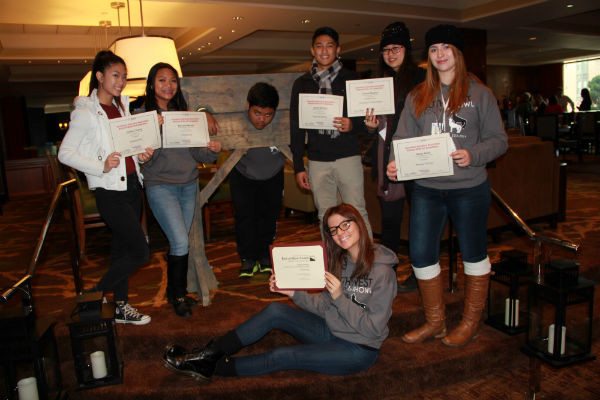 Journalism students Jenika Chiang ('16), Tamara Navarro ('16), Alexandra Nedelcu ('15), Michelle Manuel ('14), Jacob Berroya ('14), Sahar Kanfi ('14), and Ricardo Reyes ('14) pose for a picture with their earned awards from the conference.  Photo Credit: Hailey Basner