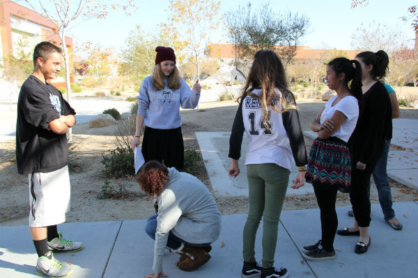 A group of Student Council members participate in an activity in which they had to get over the person in front of them without walking out of the line.  Photo Credit: Hailey Basner