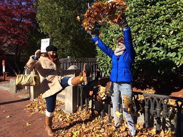 Senior Sahar Kanfi and junior Alex Nedelcu play in the leaves while on a tour of Salem. They are taking part in the NSPA Boston Convention, which has allowed them a break from their regular school schedule.Photo Credit: Michelle Manuel