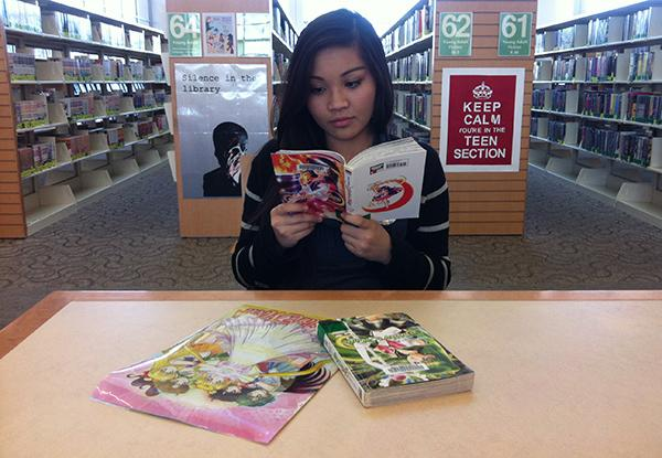 """At the library, Sophomore Marissa Villarosa is reading her favorite Sailor Moon book. She has read every book and watched all 200 episodes of the television show. """"I feel like Sailor Moon motivates me to be a better person. She sees people for their personality, not their outside appearance. She is dependable, honest, and trustworthy.""""  Photo Credit: Mika Pagado"""
