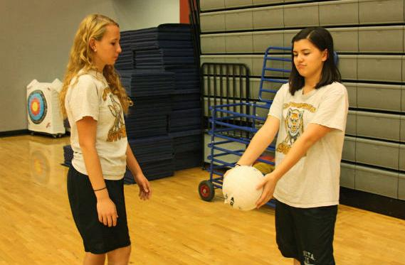 "Sophomores Savannah Rush and Katherina Pacheco did not have access to the net after the meeting was cancelled. They instead found an open area and practiced passing the ball to each other. ""It was disappointing that Volleyball Club didn't have the nets but it was still fun to play volleyball with my friend,"" Rush said.  Photo Credit: Jorge Carrera"