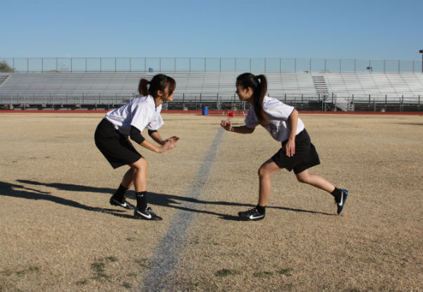 Sophomores Alyssa Bui and Jen Chiang practice plays on the field before their first game.  Photo Credit: Jenny Li