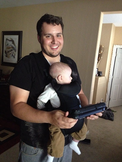 """Mr. Nathan Jayme combines his two favorite things, being a father and playing video games. He likes that video games allow him to connect with his family and they can all play together. """"We want our kids to play those games that we grew up with,"""" Jayme said."""