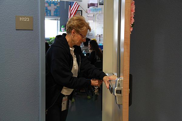 """Respiratory Therapy teacher Mrs. Vicki Smith locks her classroom door as soon as the soft lockdown announcement was made. The soft lockdown was initiated at 7:40 a.m. this morning and lasted until 8:05 a.m. """"The soft lockdown alarmed me, but I'm glad that we have it. I felt safe in the classroom, """" senior Herpreet Singh said. Photo Credit: Bree Eure"""