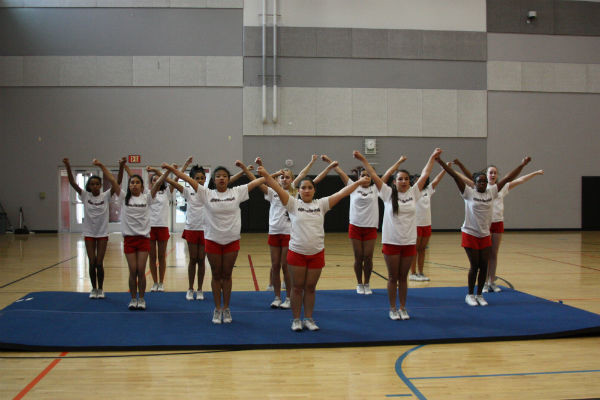 The Coyote Cheer Club practices a few cheers in the Coyote Gym on Feb. 18.  Tryouts will be held from May 19-22.  Photo Credit: Miruel Talaro