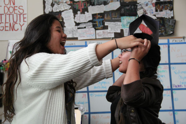 """Sophomores Kayla Delgado and Ghaylbreann Ferrar re-enact Napoleon's crowning. """"It was a fun project, because it's wasn't a written assignment and I had a lot of fun,"""" Ferrar said.  Photo Credit: Tamara Navarro"""