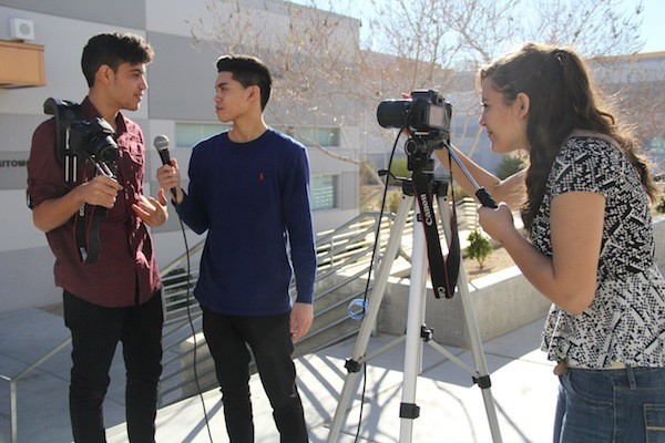 """Broadcast Journalism students film for the morning announcements before school each day. There have been 11 annual CCSD Broadcast Journalism Festivals in the past. """"We are so happy to be sponsored this year by Valari's dad. Without him, there would be no award ceremony,"""" Kozell said.  Photo Credit: Alex Nedelcu"""