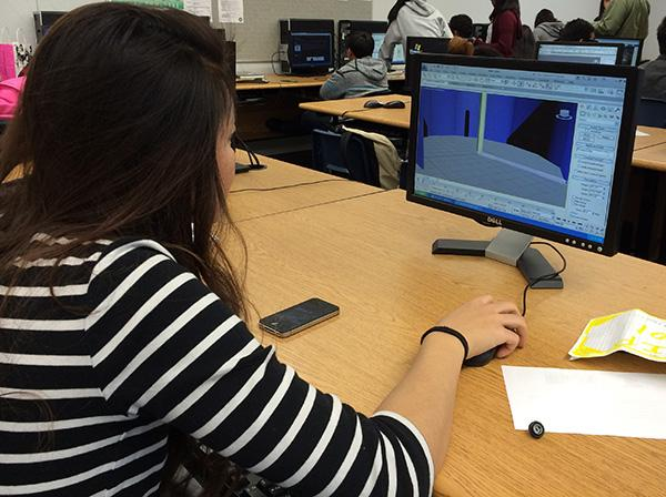 "Sophomores in Mr. Danny McElroy's CADD design class have been assigned to make virtual revolving doors that move. Students will be using Autodesk programs such as 3DS Max to help them complete this task. ""I'm kind of nervous to get further along in this assignment because there's a lot of little layers that you can easily pass over,"" Sophomore Wendy Feng said.Photo Credit: Aleeah Adamovich"