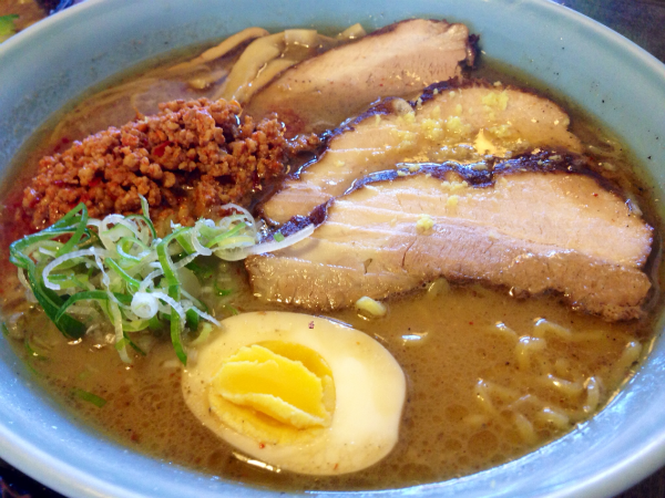 A bowl of an extra large Spicy Miso ramen from Ramen Sora. Open every day of the week, many of the customers are regulars here. With consistent quality and cheerful staff, Sora continues to stay on the top.  Photo Credit: Saramei Kalaoram