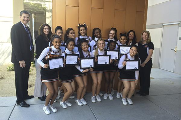 """The Coyote Cheer Club were visited by Congressman Healy who discussed with them what makes a team successful and how the cheer team should be proud of their handwork. """"It was really nice for him to come to our school and give us certificates individually. It made us all proud of one another,"""" Calder said.  Photo Credit: Alexus Brower"""