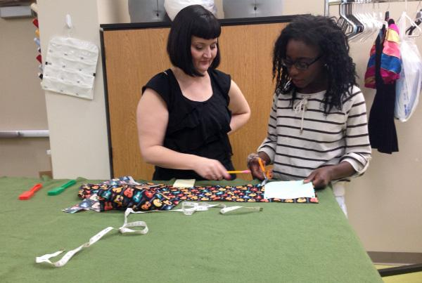 """Ms. Shannon Sheldon and freshman Benedicte Z. Rubangura work on making a sample quilt for the Spring PBL. The quilts will then be donated to a charity of the students' choice. """"I am really excited for this spring PBL because quilts are more fun when you make it for less fortunate people,"""" Rubangura said.  Photo Credit: Damaris Bravo Reyes"""