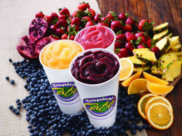 """Tropical Smoothie Cafe, often referred to simply as Tropical Smoothie,  is nutritional cafe that offers a variety of selections, such as smoothies, salads, wraps, and sandwiches. The cafe is famous for their wide array of healthy smoothies, ranging from simple flavors such as Mango Magic to more peculiar combinations, such as Beach Bum. """"What I love about Tropical Smoothie is how their smoothies are both healthy, and delicious. Whether you're on a diet, or looking for something good to drink, Tropical Smoothie is the place to go,"""" Priscilla Llanos ('17) said.  Photo Credit: Tropical Café Smoothie"""