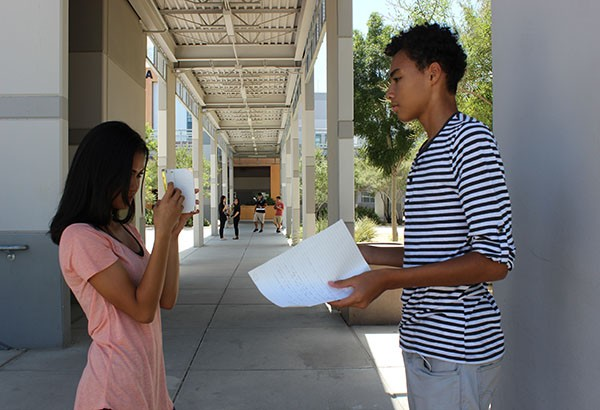 "Freshmen Alexandra Canaverala films her group mate Isaiah Scovilla introducing their assigned tenet. Their group filmed a skit for the work ethic tenet. ""I think the purpose of this assignment is to become familiar with all of the different tenets,"" Canaverala said.  Photo Credit: Jen Chiang"