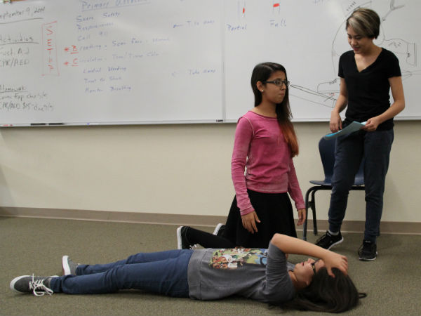 "Freshmen Téa Burnett, Mikayla Cabildo and Caitlin Tipon perform a roleplay involving a head injury. They learned how to medically respond to head injuries following the proper procedures. ""The learning experience was very hands-on and I know it will be very valuable when an emergency takes place,"" Cabildo said.  Photo Credit: Shamaeka Pagado"