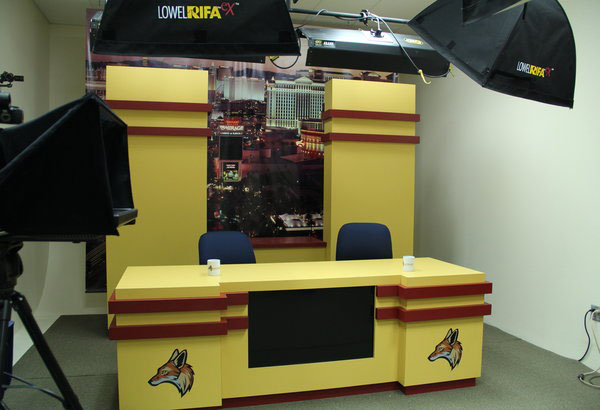 """The Rout(e) 131 studio was renvoated this summer. New aspects of the studio includes a new desk and back drop. """" There's no negatives about having a brand new set, except for maybe the fact that it will ake our anchors look a little small condisering its massive size,"""" News Anchor, Carlos Leyva said.  Photo Credit: Helen Abraha"""
