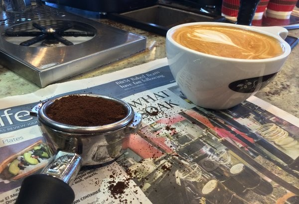 Pulling a shot of espresso and managing a newspaper staff is strangely similar.  Photo Credit: Alex Nedelcu