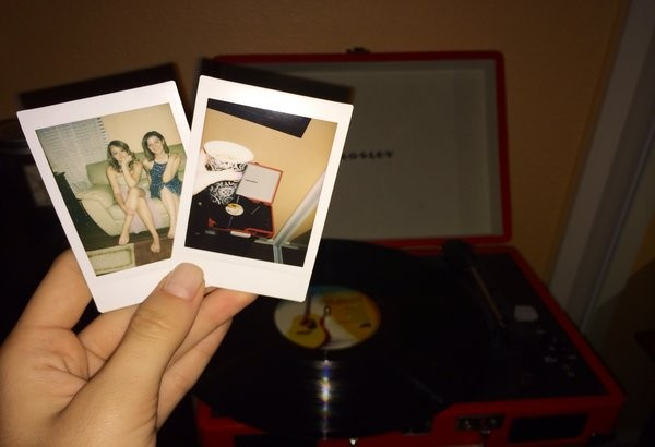 Love for inanimate objects is completely acceptable and recommended, such as my love for capturing moments on polaroid film and my record player.  Photo Credit: Alex Nedelcu