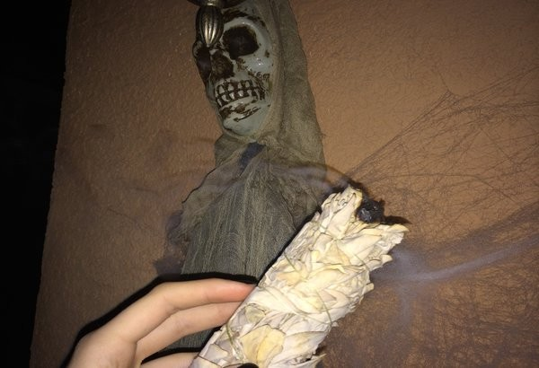 Not that I consider myself to be more superstitious than the average teenage girl, but burning sage onto the Halloween decorations that are hung on my house seems like the best idea to help me overcome my fear.  Photo Credit: Alex Nedelcu
