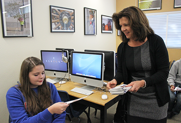 "Sophomore Emily Bennett receives a pamphlet regarding scholarship opportunities from President Linda Bonnici of the Nevada Broadcasters Foundation (NBF) on Nov. 17. Bonnici and Executive Director Eric Bonnici spoke to interested broadcast journalism students about the application process. ""I know I want to study something that has to do with broadcast journalism and I think it's pretty cool that we can get a scholarship for it,"" Bennett said.  Photo Credit: Jen Chiang"