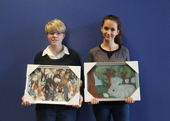"""Junior Mariya Zlateva and Sophomore Kristin Stanton won the Silver State Schools Credit Union's 20th annual Happy Times Calendar contest. Their artwork appeared in the calendar for the months of April and Sept. """"It really made my day when I found out that I won. I still can't believe it,"""" Zlateva said.  Photo Credit: Jen Chiang"""