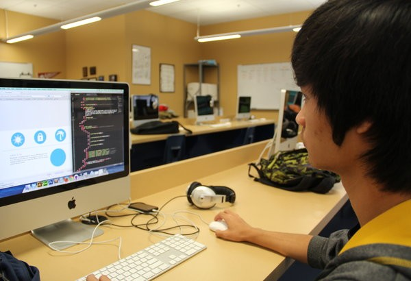 """Senior Darren Wong visits the Hour of Code website in order to gain information that could be used during Hour of Code on Wednesday. The day will allow students to gain the basic skills of coding, which could potentially help them in their field of study. """"I feel as if no one takes the hour of code seriously, but if they did it would be a learning experience for anyone interested in coding,"""" Wong said. Photo credit: Helen Abraha"""