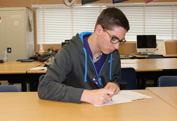 """Junior Brandon Hatch edits his poem for the writing contest. There are 28 categories and Hatch has entered his work for poetry. """"Writing has always been my forte and this competition seemed like a nice opportunity to indulge in something academic that I'm actually passionate about,"""" Hatch said.  Photo Credit: Acel Soriano"""