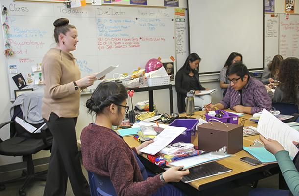 """Student Council (StuCo) adviser Mrs. Miriya Julian announces the Battle of the Sexes and Sadie Hawkin's Dance theme. StuCohas been arranging the details of the eventsfor the past two weeks. """"I think that Battle of the Sexes and Sadie's will be a success this year. We are really trying to make it into a school event that every student can participate in,"""" senior Hugo Silva said. Photo Credit: Helen Abraha"""