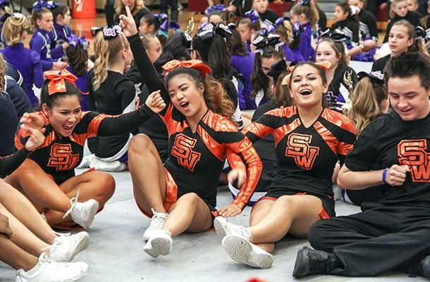 """Freshman Rebekah Chang and seniors Abby Calvelo, Deanne Dimatulac and Philip Hagen exclaimas the Coyote Cheer team is announced as the first place winner at the 2015 Vegas Classics Competition. The group was selected to move on to the national competition in Anaheim, Calif.""""I felt really ecstatic. It was our first competition of the season and to be able to win and get a bid to nationals just set us in a good place for the rest of our competitions,"""" Dimatulac said. Photo credit: Emily Yu"""