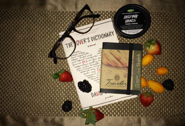 My recipe for happiness: sappy poetry, glasses, fruit, sketchbook, and hand lotion.  Photo Credit: Alex Nedelcu