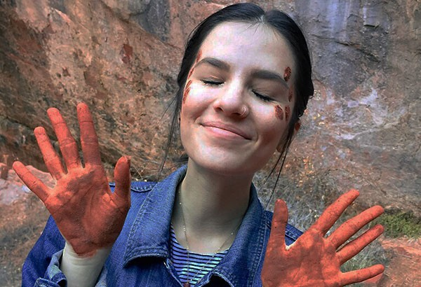 At Zion National Park in Utah, on the hike to the emerald pools, there are various sources of water which turn the mud in the park a clay-orange. It was almost impossible for me not to play with it. To commemorate the beauty, I asked one of my hiking partners to draw on my face with it.  Photo Credit: Ciprian Nedelcu